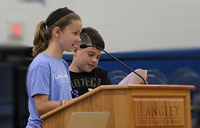 Students presenting during the assembly